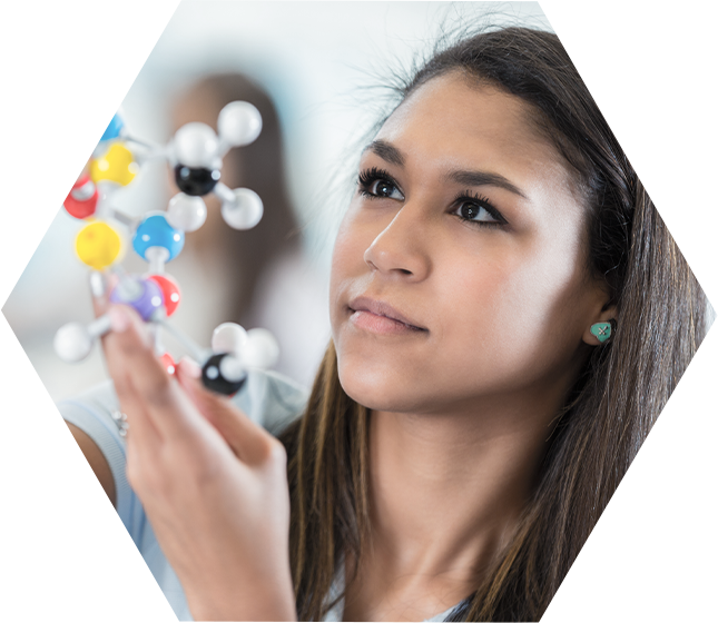 girl looking at science atoms